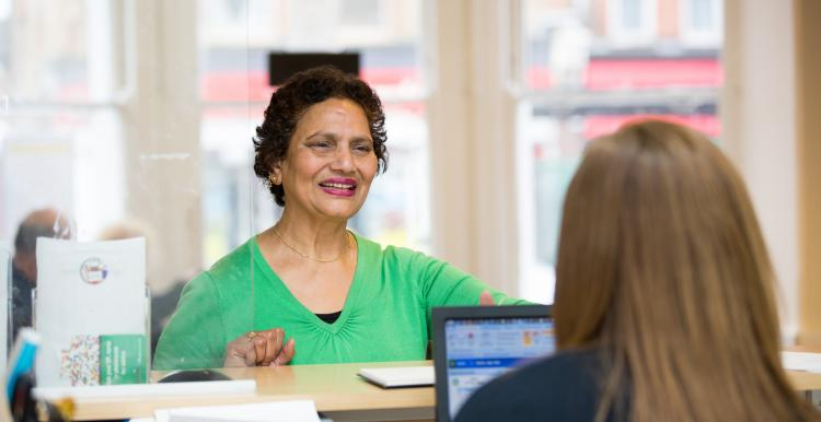 Woman at reception desk
