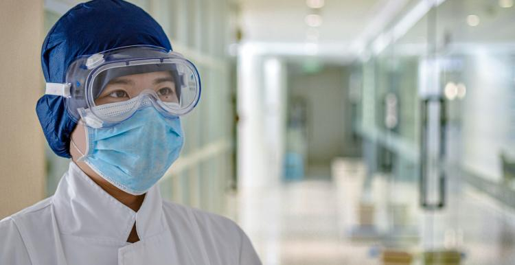 member of staff in ppe