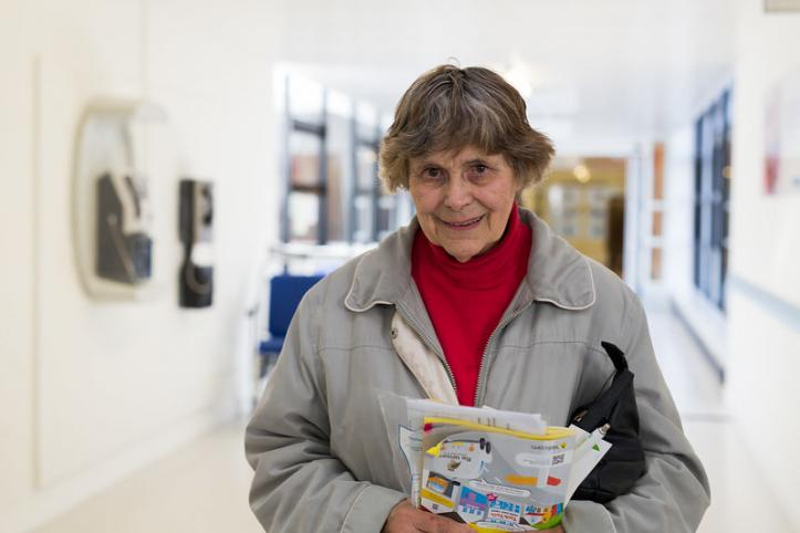 Woman holding information