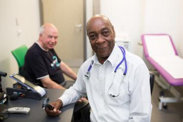 Male doctor speaking to a patient