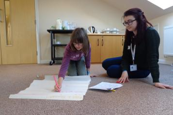 Young Healthwatch child writing
