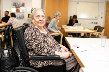 Women in powerchair at table