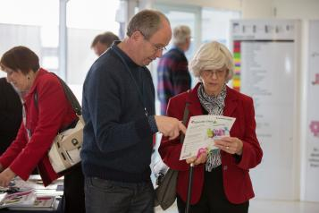 Man and woman talking about leaflet