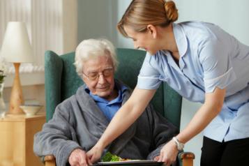 Nurse with elderly patient