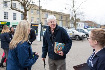 Man with walking stick talking to Healthwatch