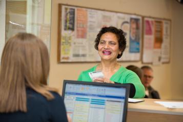 Woman talking to receptionist