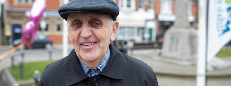 older man smiling at camera